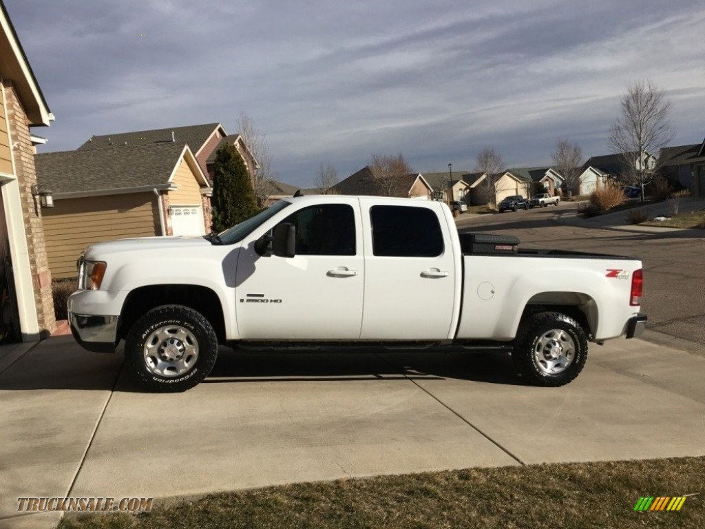 2009 Sierra 2500HD SLT Crew Cab 4x4 - Summit White / Ebony/Light Cashmere photo #1