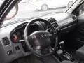 Nissan Frontier XE V6 Crew Cab 4x4 Super Black photo #13