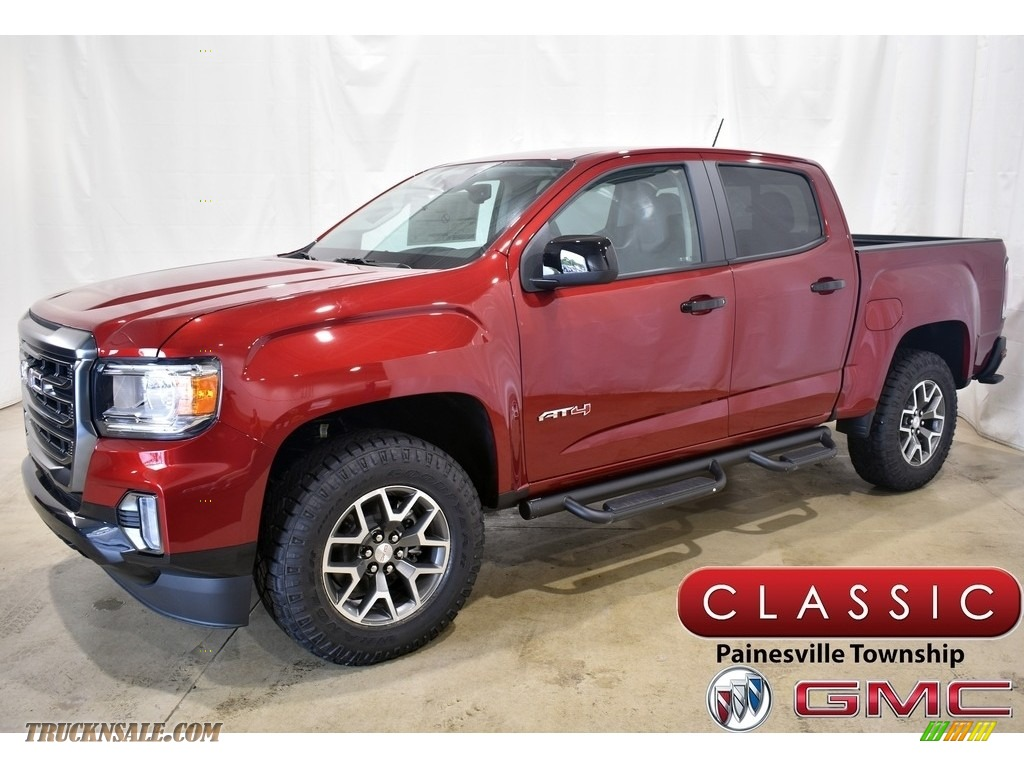 Cayenne Red Tintcoat / Jet Black/Kalahari GMC Canyon AT4 Crew Cab 4WD