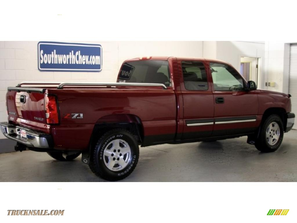 Sport red metallic dark charcoal chevrolet silverado 1500 z71 extended cab 4x4