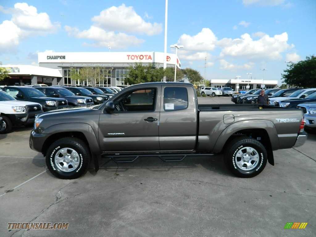 2012 toyota tacoma v6 trd access cab 4x4 in pyrite mica 024607 truck n 39 sale. Black Bedroom Furniture Sets. Home Design Ideas