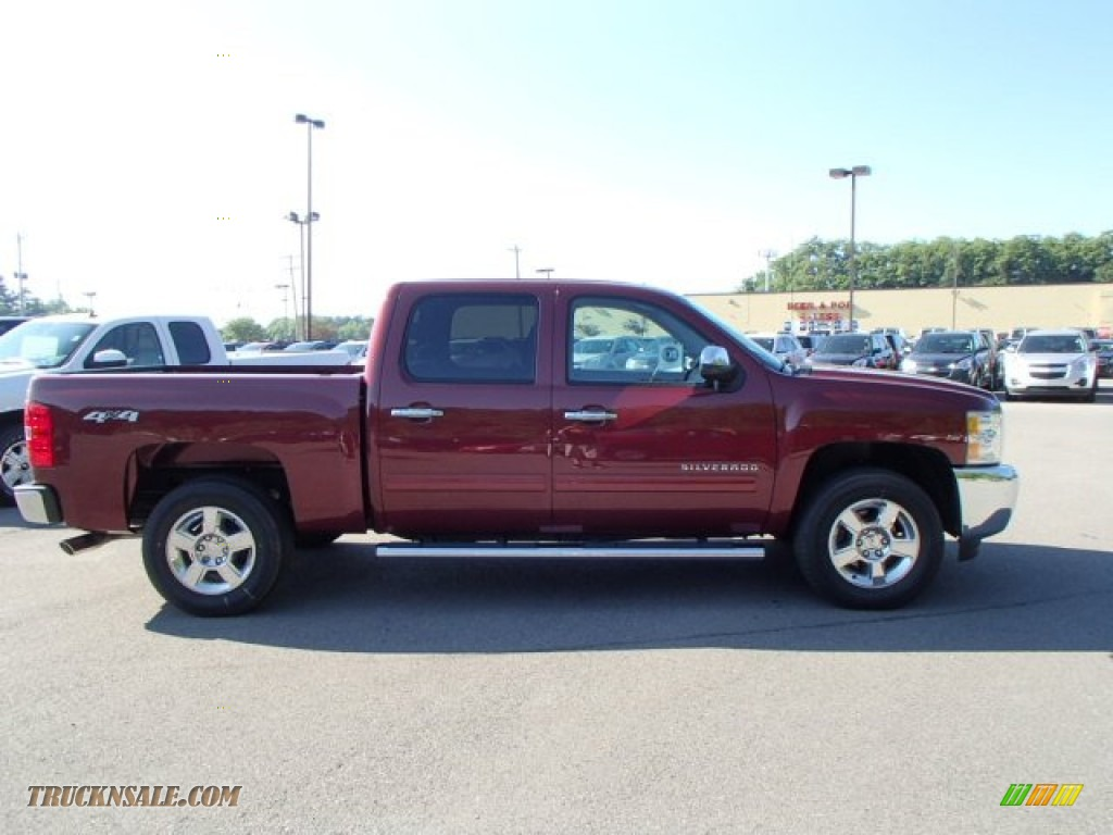 Chevy Touch Up Paint Pen 2013 Silverado 1500 LT Crew Cab 4x4 - Deep Ruby Metallic / Ebony photo